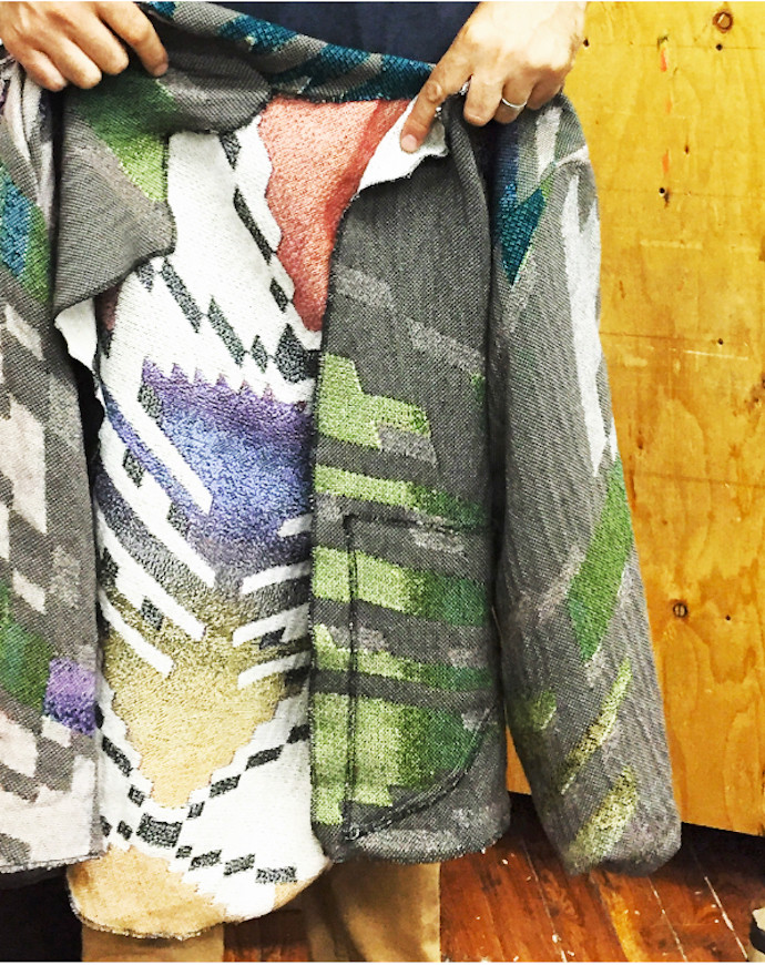 artist David Smith reveals the reverse side of one of his colorful Jack and Stish blanket jackets; photo erica lewis