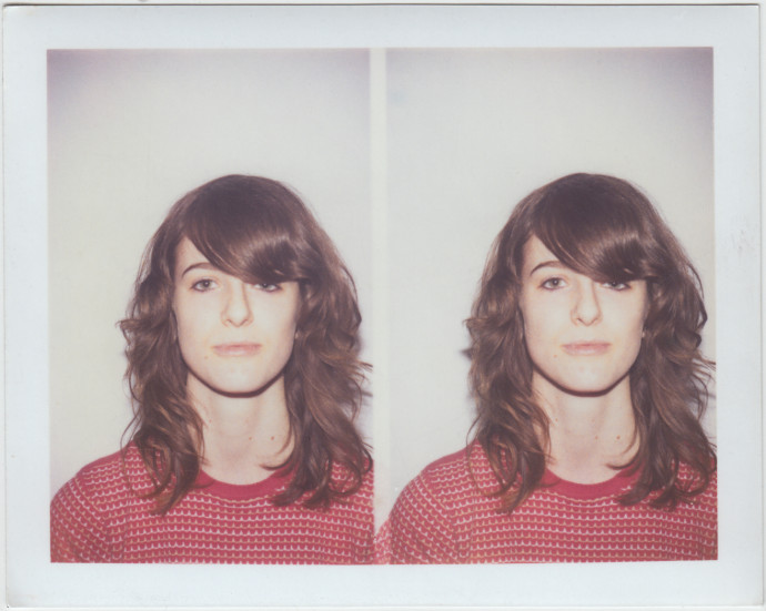 Polaroid of Chelsea Hodson at 17, taken while working at FedEx Kinko's, before the film passport camera was replaced by a digital one.